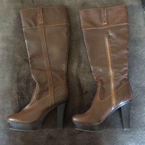 Lauren Conrad platform high heeled boots.